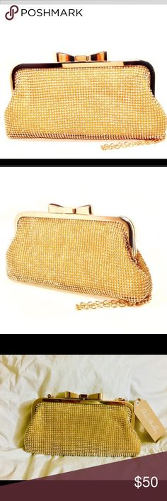"""💛 Ribbon Rhinestone Clutch 💛 Look amazingly glamorous with this glittery clutch adorned with eye-catching rhinestones. This gold clutch is the perfect accessory for that cute holiday outfit.   ▫️8.5"""" W x 4"""" H x 1"""" D ▫️23"""" max. strap drop ▫️push-lock closure ▫️metal ▫️removable strap ▫️imported Pink Haley Bags Clutches & Wristlets"""