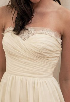 Love the neckline of this wedding dress, simple, cream colored, sweetheat share and lots of ruching. A little vintage looking, too.