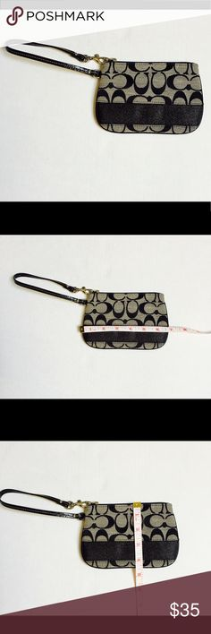 Coach wristlets . Black and GRAY . NWOT Coach wristlet . Never  been used before . Perfect for a night out or day out. Coach Bags Clutches & Wristlets