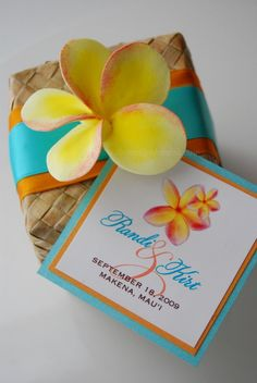 Hawaiian wedding favors- boxes filled with Macadamia nuts smothered in chocolate and caramel.