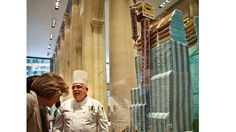 """Emile Castillo, center, an executive chef at Le Parker Meridien hotel, standing by his gingerbread creation ""The Hurri-CANE"" at his hotel in New York."" (AP)    Read more: http://www.foxnews.com/travel/2012/12/03/not-your-mother-gingerbread-gingerbread-houses-get-out-kitchen-and-into-hotel/#ixzz2EBVM6GpG"