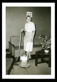 "vintage 1950s housewife with pod vacuum.  (A good attempt at ""candid!"")"