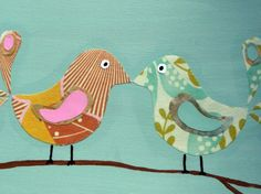 I may have to try these birds myself. This website has a kit and it says the birds are fabric that is decoupaged on the canvas using several coats. The branch was handpainted with acrylic paint.