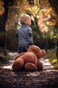As every season passes, cherish every moment you have with your little ones. This photo is such a quaint reminder of childhood memories during those cozy fall months. with a teddy bear