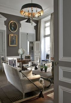 Gray walls with white trim and molding. Jean Louis Deniot