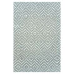 Hand-woven indoor/outdoor rug with a diamond motif.    Product: RugConstruction Material: PolypropyleneColor: Blue and ivoryFeatures:  Hand-wovenSuitable for indoor or outdoor use Note: Please be aware that actual colors may vary from those shown on your screen. Accent rugs may also not show the entire pattern that the corresponding area rugs have. Cleaning and Care: Vacuum regularly. Hoseable, scrubbable, and bleachable. Air dry.