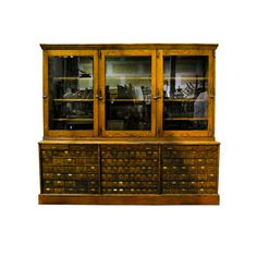 Fantastic 2 piece solid oak merchandising cpounter..with beveled glass doors and over 100 small drawers. ...