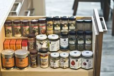spice rack hidden in a pullout drawer, multi level with adjustable shelves