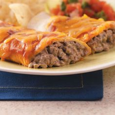 Creamy Beef Enchiladas ~ This recipe for contest-winning American-style enchiladas is rich, creamy and loaded with cheese. Kids will like the texture and the fact that they have just a touch of south-of-the-border heat.