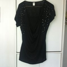 Lady's Black Dressy Pull-over Top (NWOT) Lady's dressy short sleeve low cut swoop neck with shimmer on the front of the sleeves. (NWOT)! Hybrid Tops