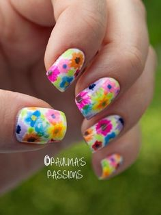 Yet another cute flower inspired watercolor nail art. This style uses various nail polish colors for the many flowers painted on the nails. It looks perfect for the warm summer season.