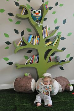 tree logs   tree shelf playroom with synthetic turf grass and log pillows