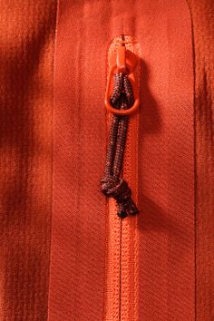 Hyllus-Jacket-Iron-Oxide-Laminated-Pocket-zipper-detail.jpg…