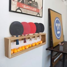 Ping pong racquet and ball rack