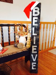 BELIEVE sign made from an old picket fence board. Letters cut with a Cricut. Lightly painted the board off-white. Cut letters with Cricut using Contact paper as the vinyl. Stuck letters on board and painted entire board black.