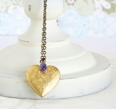 Heart Locket Necklace Purple Swarovski. Could Easily DIY by buying a cheap locket from the antiques market and jazzing it up with your choice of crystal bead! (and for far cheaper dare I say)