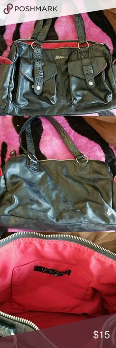 Nwot Volcom purse Black with red interior. Has inside pocket and 2 side pockets that snap. Medium size. Soft pleather material. Volcom Bags Shoulder Bags