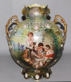 """Antique RS Prussia Porcelain Portrait Vase Titled """"Melon Eaters"""" The vase is accented with double gold gilt handles along with blown out porcelain opal jewel motif Good China, Prussia, Fine Porcelain, Shabby, Glass Design, Sevres, Glass Art, Sculptures, Pottery"""