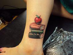 45 Charming Book Tattoo Designs Ideas For Bookworms - VIs-Wed Body Art Tattoos, New Tattoos, Small Tattoos, Sleeve Tattoos, Tatoos, Teaching Tattoos, Apple Tattoo, Literary Tattoos, Book Tattoo