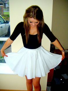 black shirt with flowy white skirt