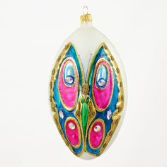 Oval ornaments have an elegant appearance. This one inparticular. Colorfully decorated, this ornament is sure to adorn. Marek Morawski the lead ornament artist at P.W. Wiktoria in Łódz, Poland and ori