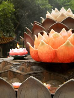Lotus Candles in a Buddhist Temple, China.* Arielle Gabriel writes about miracles and travel in The Goddess of Mercy & The Dept of Miracles also free China toys and paper dolls at The China Adventures of Arielle Gabriel *