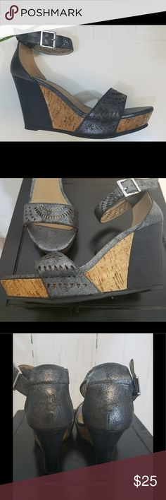 Diba Wedge Sandal Diba partially cover shiny cork wedge sandal with ankle strap and buckle enclosure.  Laser cutout designs on straps completes this beautiful look.  All man made materials.  Gently worn - in goo condition.  Size 7.5 M.  Heel height is 3.5 inches.  Offers are welcome.  Color: Metallic Black Diba Shoes Wedges