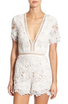 Cut-out lace and sheer ladder-stitched detailing adds beautiful texture to this ethereal romper from Missguided.