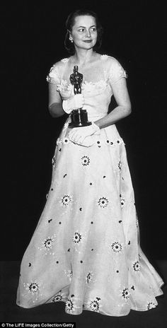 Olivia De Havilland in 1947 in dress by Ann Lowe of Sonia Gowns, which  was a romantic pale green shade with pink flower decorations