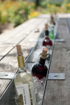 This is a great idea remove the plank from the picnic table insert a metal trough. add ice add wine have fun