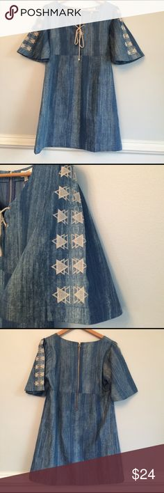 """Umgee Chambray Denim Embroidered Boho Dress NWT Adorable little dress that will be a go to for you all spring and summer long! Cotton blend to keep you cool and looking fine. The embroidered bell sleeves have me second guessing this listing. :) Measurements lying flat: 18.5"""" underarm to underarm, 17"""" empire waist and 32.5"""" shoulder to hem. Perfect condition - new with tags. Umgee Dresses"""
