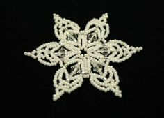 You can find this Snowflake pattern here: http://store.sandradhalpenny.com/snowflake-17-ornament-pattern-p90.php
