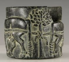 """Very Rare Bactrian Jar with Figural Scene, 2nd ML BCA carved chlorite(?) jar with high-relief image of two oxen tied to a tree, inverted nude male between them. 222 grams, 64mm (2 ½""""). Vessels made from steatite or chlorite have frequently been found..."""