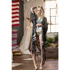 Bohemian Royala tassel kimono charcoal - This hand-crocheted tassel kimono features Spell´s hand-drawn Bohemian Royale print in smokey charcoal hues and floral flecks of cream & chocolate. The soft black tassels flow down from the asymmetric 'v' shaped hem and sleeves. Perfect over skinny jeans or vintage denim cut-offs or thrown over that little black slip that needs a bohemian touch. The tassel kimono comes complete with a hand-plaited belt so you can wear it belted if you choose. 100%…