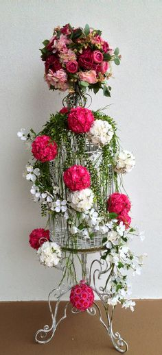 #Bird cage with kissing balls. Designed by Arcadia Floral & Home Decor