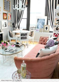 Black & white striped curtains. White table & chairs. Pink tufted sofa. Gray walls. Love.