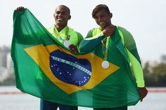 Erlon De Souza Silva of Brazil and Isaquias Queiroz dos Santos of Brazil celebrate winning the silver medal in the Men's Canoe Double 1000m Finals on Day 15 of the Rio 2016 Olympic Games at the Lagoa Stadium on August 20, 2016 in Rio de Janeiro, Brazil.