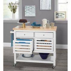Lend yourself some added surface and storage space by utilizing this timeless cart designed with shelving, drawers and cabinets. Adult Assembly Required due to the presence of small parts Rolling Kitchen Island, Kitchen Island Table, Farmhouse Kitchen Island, Kitchen Cart, Kitchen Dining, Kitchen Ideas, Small Drawers, Storage Drawers, Storage Spaces