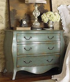 A chest like this, in a soft blue or cream color, bedside.... yes.