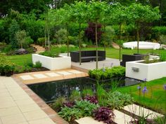 Garden seating area with pond and patios