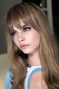 Cheekbone fringes and a collarbone layered shag. A update on the lob and the cold ashy neutral brown with very little warm tones in it is a wonderful colour, Cara Delevingne tops it with a cat eye eyeliner.