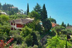 Welcome toApartments La Villa Fasano Gardone Riviera. Villa Fasano,a typical villa with seven apartments designed to enjoy the magnificient view of the Lake Garda: the Island of Garda and itssuperb Venice styled Palace, Sirmione with its castle, La Rocca, and the scenic Monte Baldo.