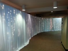 Fairytale backdrop using string lighting to cover unsightly event areas.