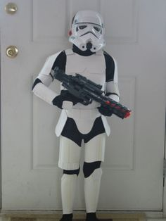 Storm trooper. Made from about 10 dollars of craft foam, velcro and elastic. They incorporated an MP3 player to blast the Imperial March.