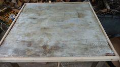 Dessus de la table consolidé d'une toile de fibre de verre et de résine.