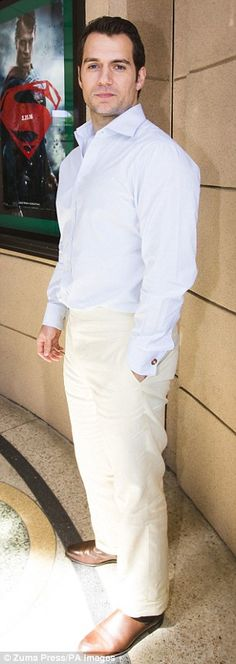 A Brit of all white: Jersey-born Henry, 32, pulled on a pair of cream tailored trousers and a crisp white shirt
