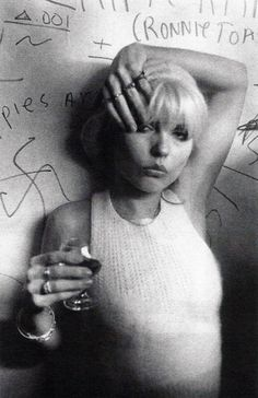 Debbie Harry. We should go punk inspiration ala Debbie Harry. That grundgy bar with the ass juice would be perfect for something like this
