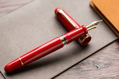 Limited to just 188 pens worldwide, Aurora is pleased to introduce a new Flex Nib to the line of the Aurora 88 model, just in time for Aurora's 70th anniversary. Each month a new limited edition color will be released; this is the second in the series. The red resin body with matching red grip is complemented by the gold trim and 14kt gold fine flex nib. It fills via piston with a built-in extra ink reserve, and you can view your ink level through the clear ink window. It is 100% handmad...