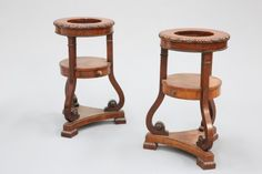 A PAIR OF 19TH CENTURY MAHOGANY WASHSTANDS, PROBABLY IRISH, circular, the tops with egg and dart
