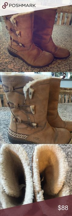 UGG lined leather toggle boots These boots are short lined in ugg sheepskin and in EXCELLENT condition. They have 3 toggles on the outside of the boot. The leather, soles, and lining are in great condition. They pair well with all outfits. UGG Shoes Ankle Boots & Booties